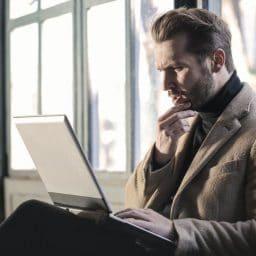 Man using a laptop.